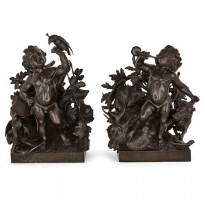Pair of bronze putti sculptures by Lechesne