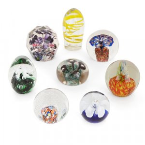 Set of eight French decorative glass paperweights