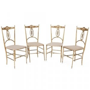 Set of four Neoclassical Chiavari style brass chairs