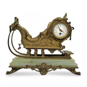 Ormolu and onyx antique mantel clock in the form of a sleigh