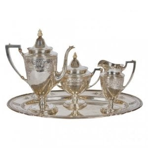 Silver four piece antique coffee service with ivory finials