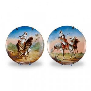 Pair of antique porcelain plates depicting Arab horsemen