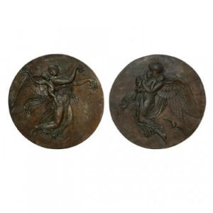 Pair of patinated bronze antique plaques of Night and Day