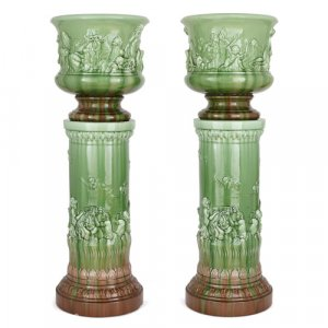 Pair of large French majolica jardinieres on pedestals