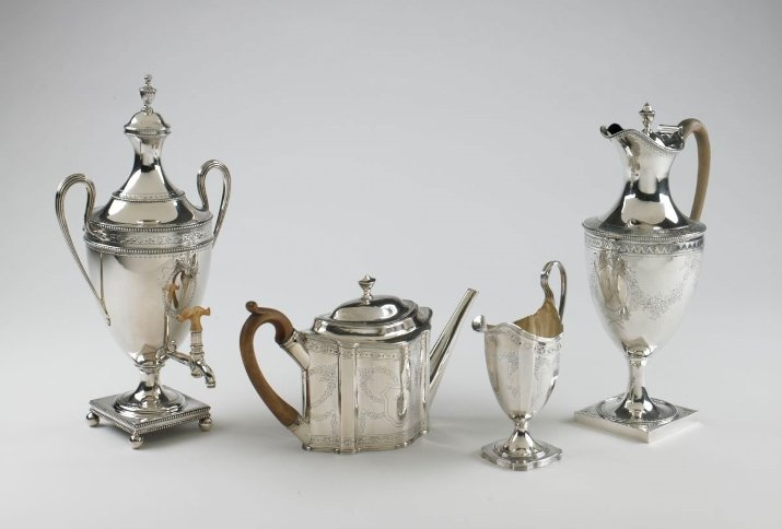 Hot water urn, a teapot, a creamer, and a hot water jug by the Bateman silversmiths