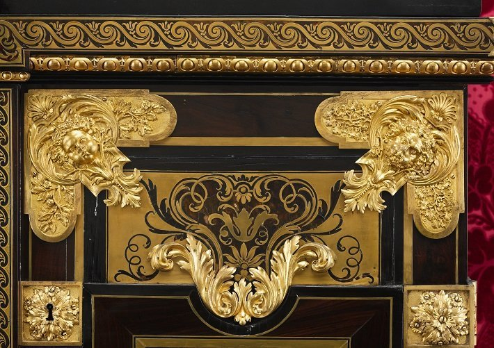 Detail from a Boulle cabinet with the distinctive black and gold colour scheme
