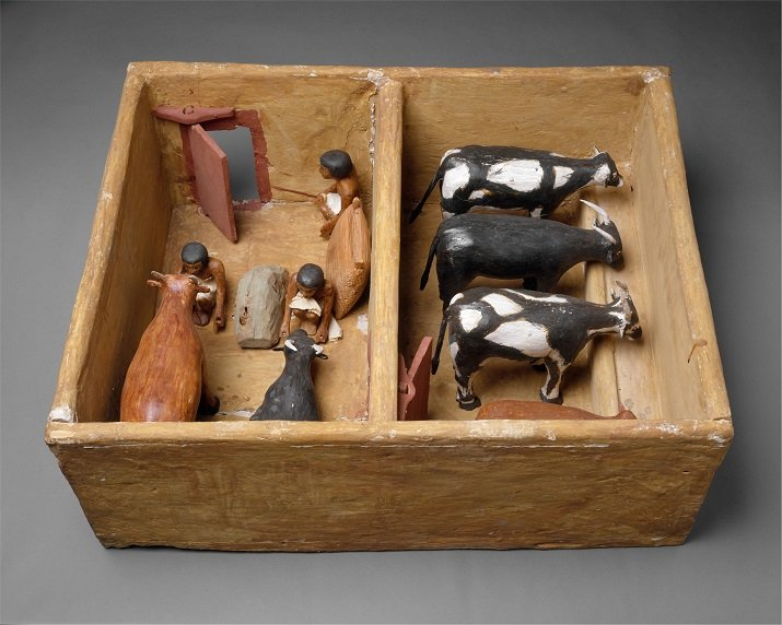 ancient egyptian carving of cattle shed